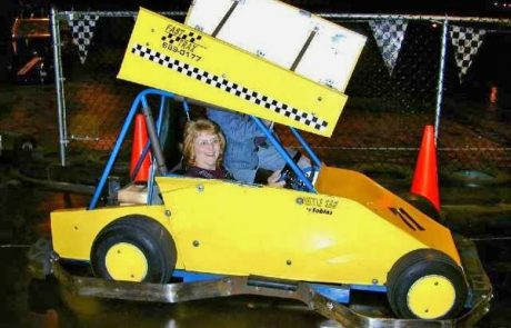 woman in yellow racecar