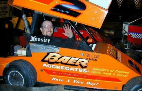Man in orange race car